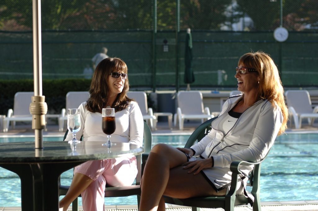 Ladies Sitting by the Pool in Tennis Club attire