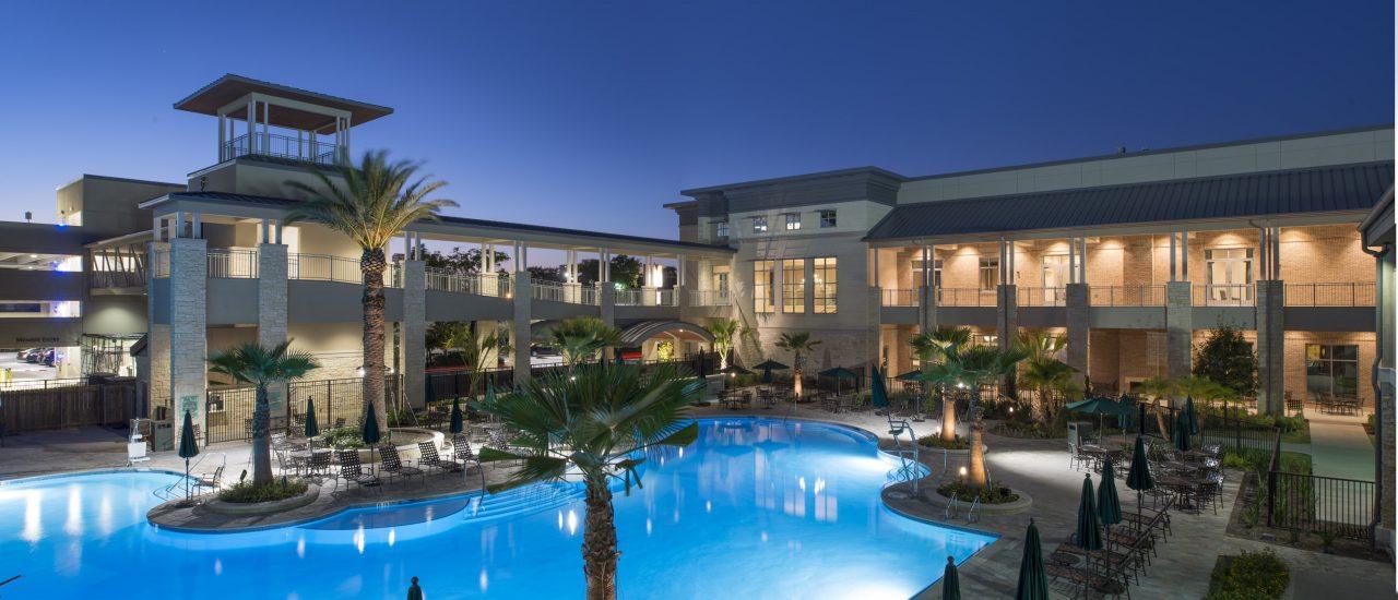 The Briar Club - Jackson & Ryan Architects - Exterior Pool - Family at Dusk