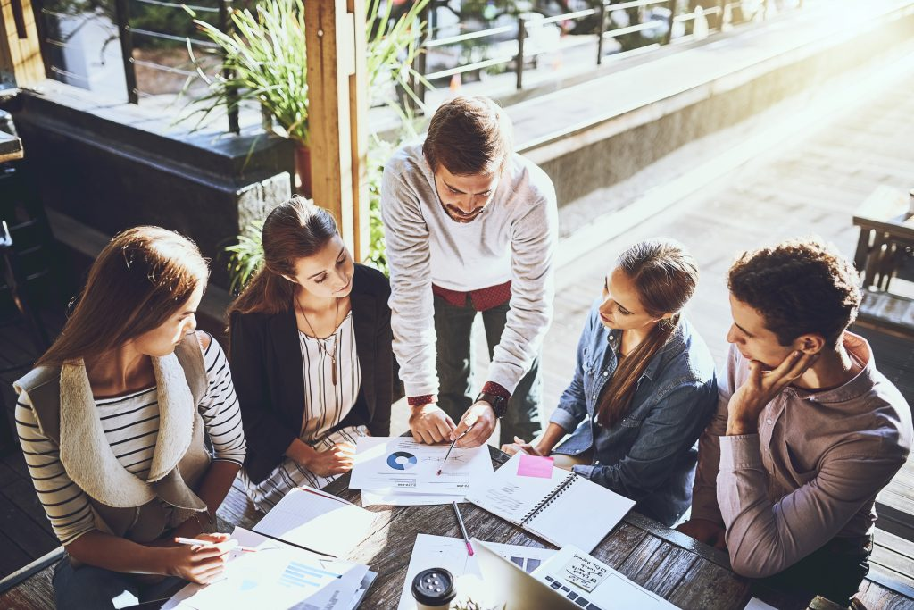 Shot of a group of colleagues having a meeting at a cafe
