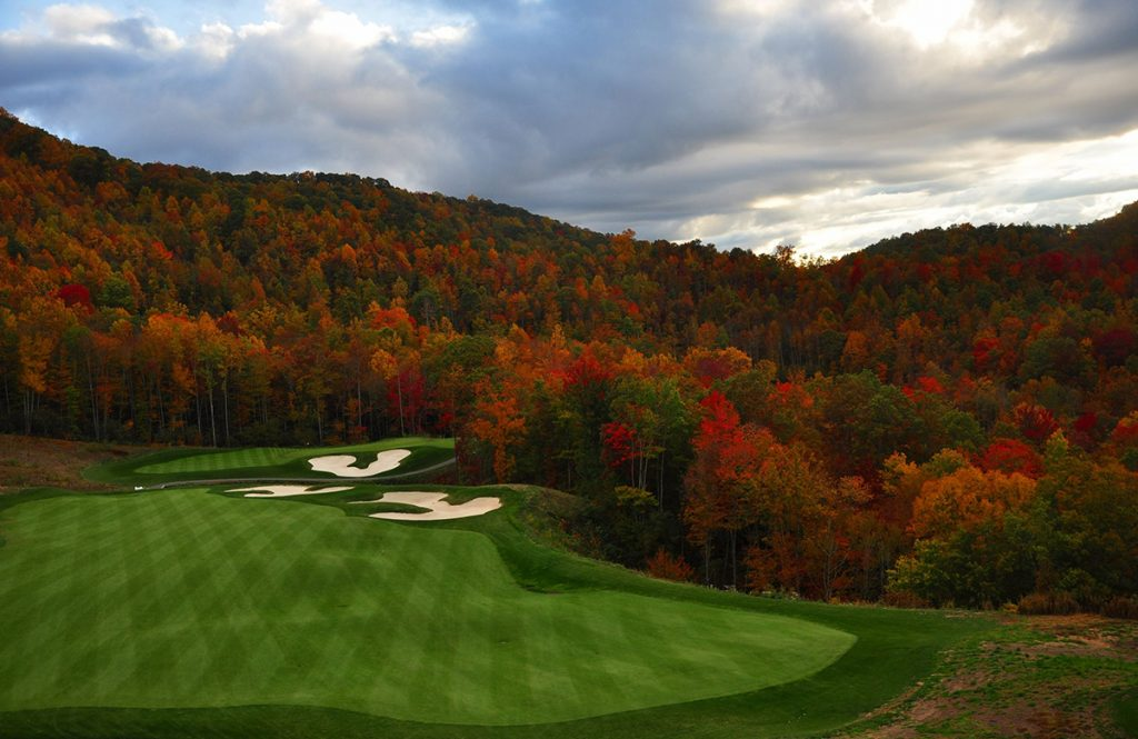 15217498 - golf course nestled in the north carolina mountains in the fall